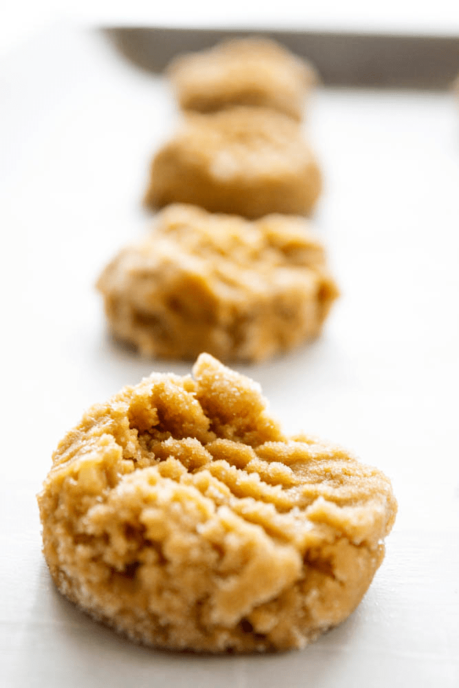 photo of unbaked peanut butter banana cookies on cookie sheet