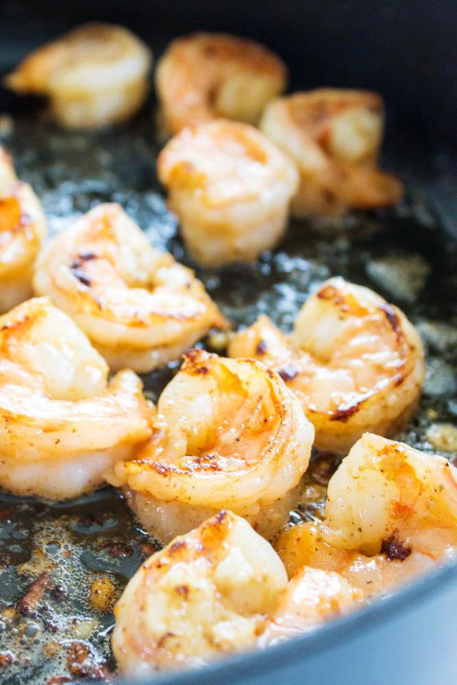 garlic shrimp cooking in skillet