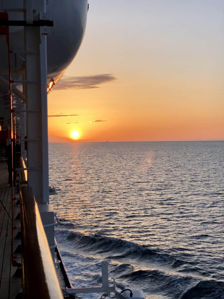 sunset over ocean from cruise ship deck