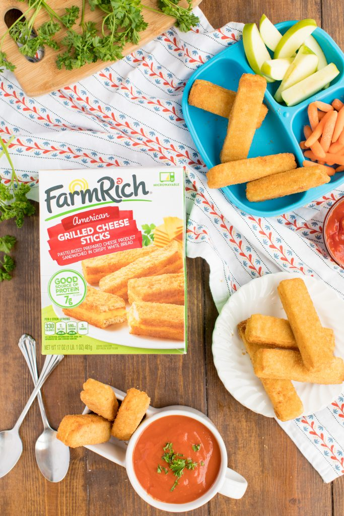 photo of farmrich grilled cheese sticks box with cheese sticks on a plate, on a kid's plate with apples and carrots, and in a bowl with tomato soup