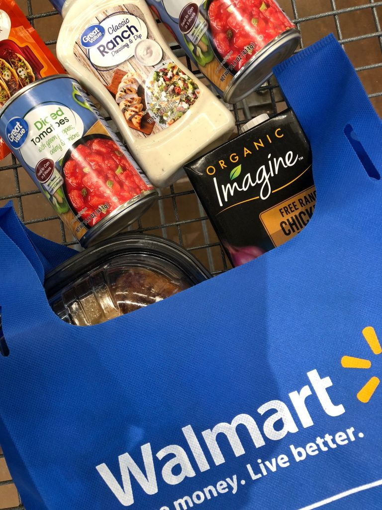 reusable walmart bag with soup ingredients in cart