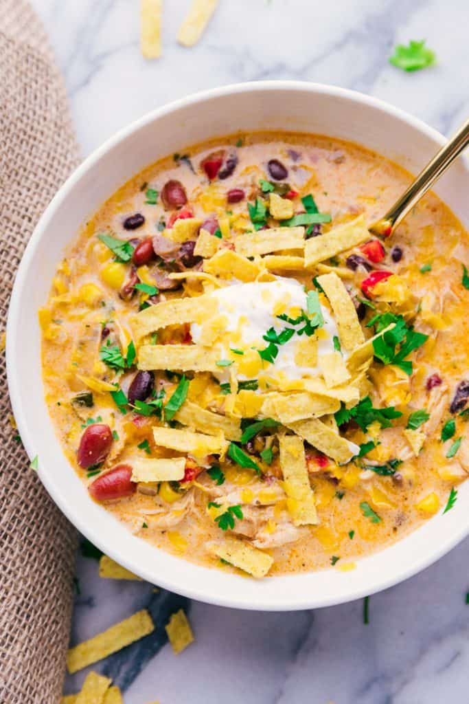 photo of a bowl of Chicken Tortilla Soup with garnishes