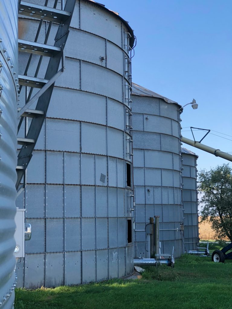 photo of a row of 4 corn silos