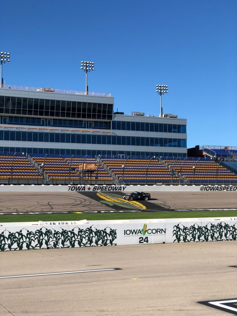 Photo of the iowa speedway with iowa corn signs on side of the track