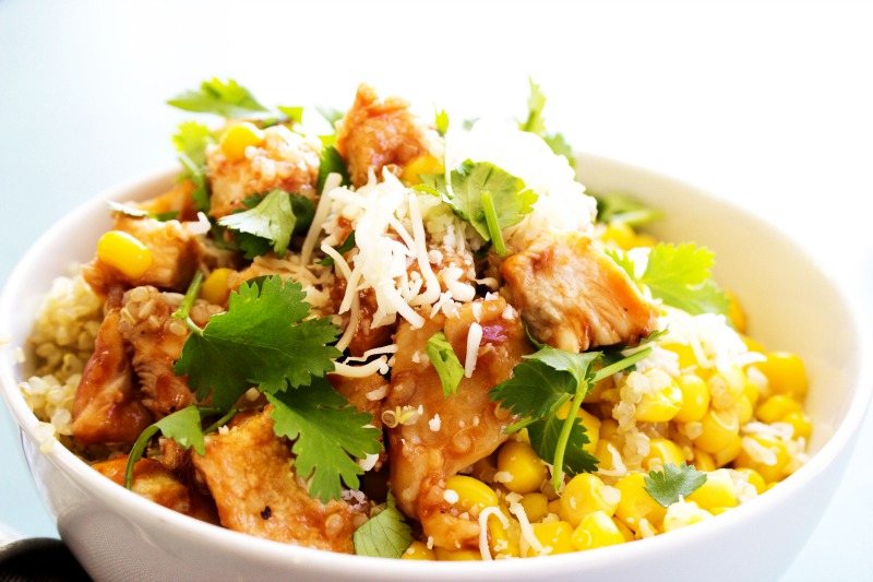 photo of  Baked Barbecue Chicken and Quinoa Bowl, white bowl, garnished with cilantro