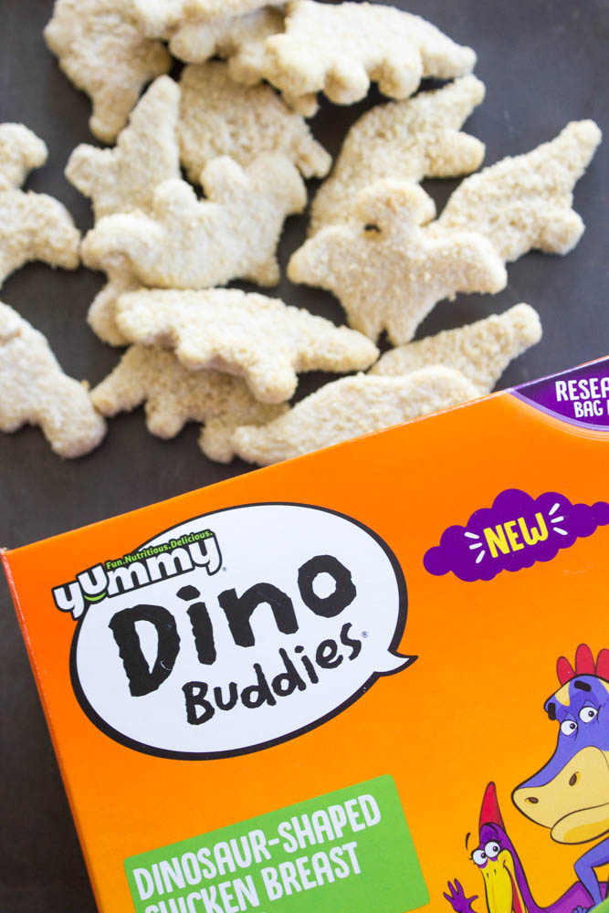 photo of dino buddies being poured out of box onto the sheet pan