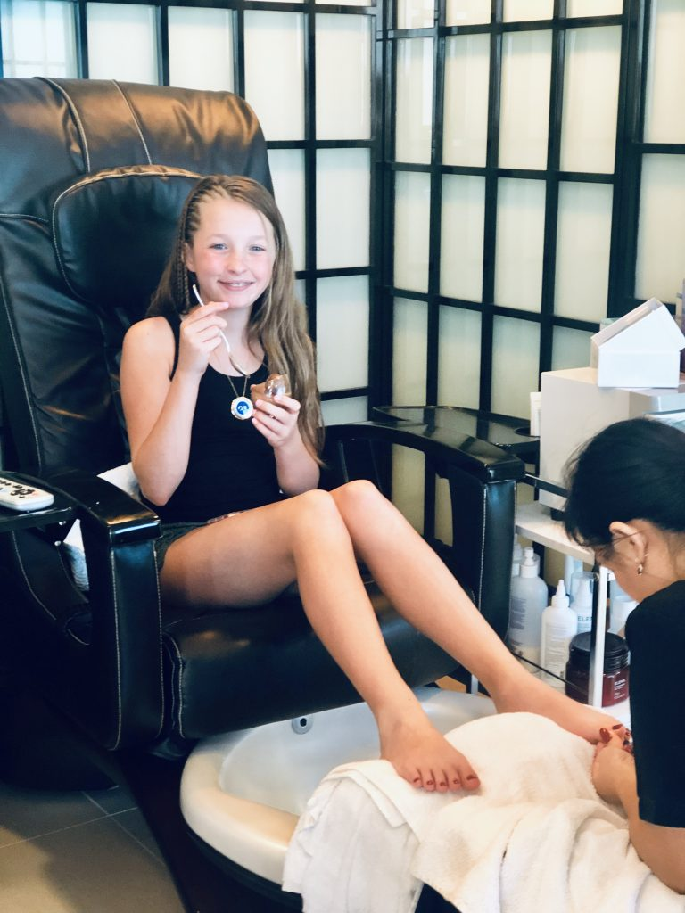 photo of jordan eating a treat while getting a pedicure