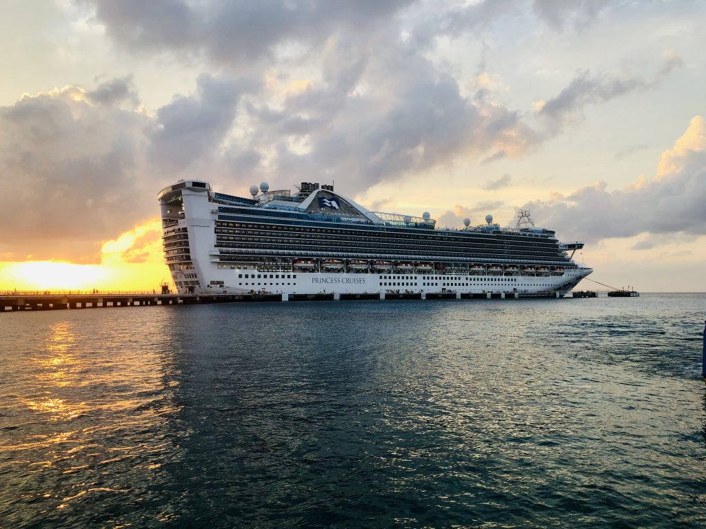 photo of princess cruises cruise ship at a dock at sunset