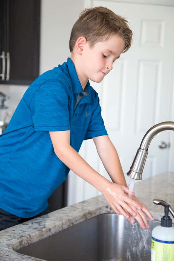 photo of a boy washing his hands