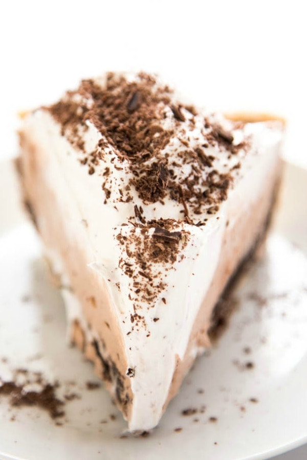 photo of slice of Chocolate Mousse Fudge Pie from front on a white plate