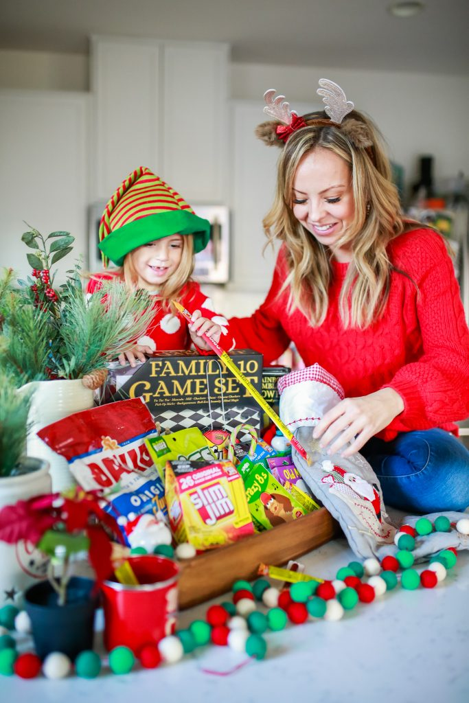 photo of mom and daugher taking slim jim out of the stocking in the Game Night Gift Basket