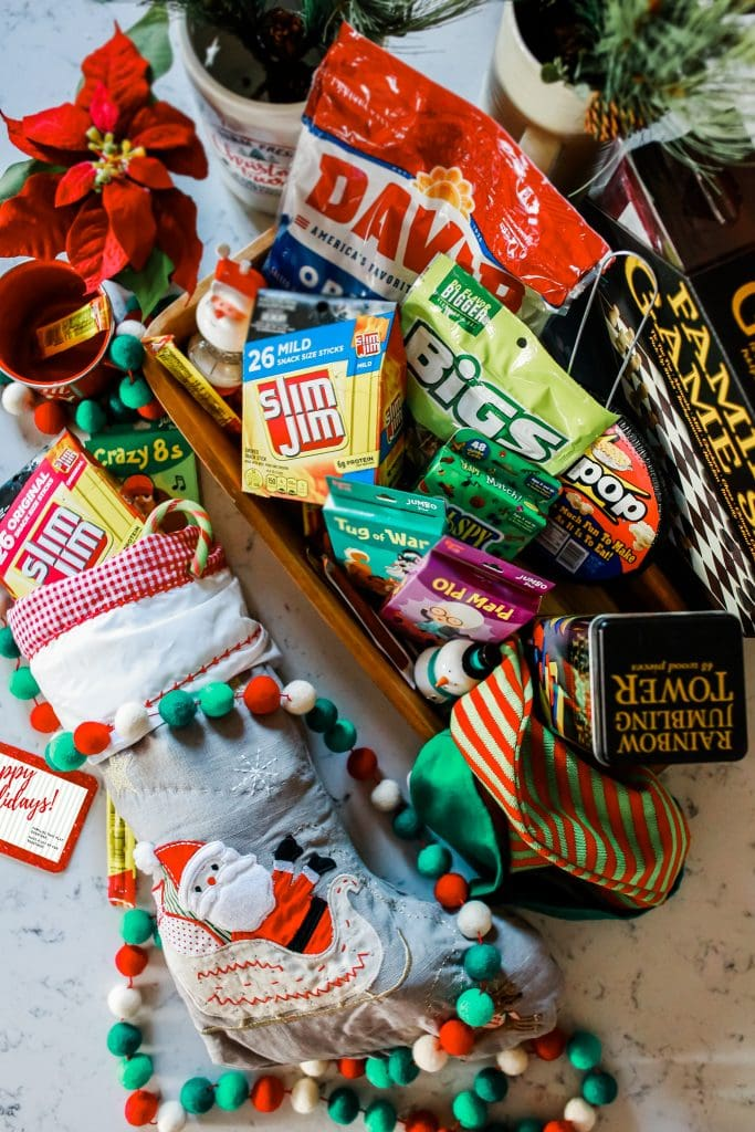 overhead photo of Game Night Gift Basket with full stocking next to it