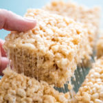 photo of a rice krispie treat being lifted out of the pan