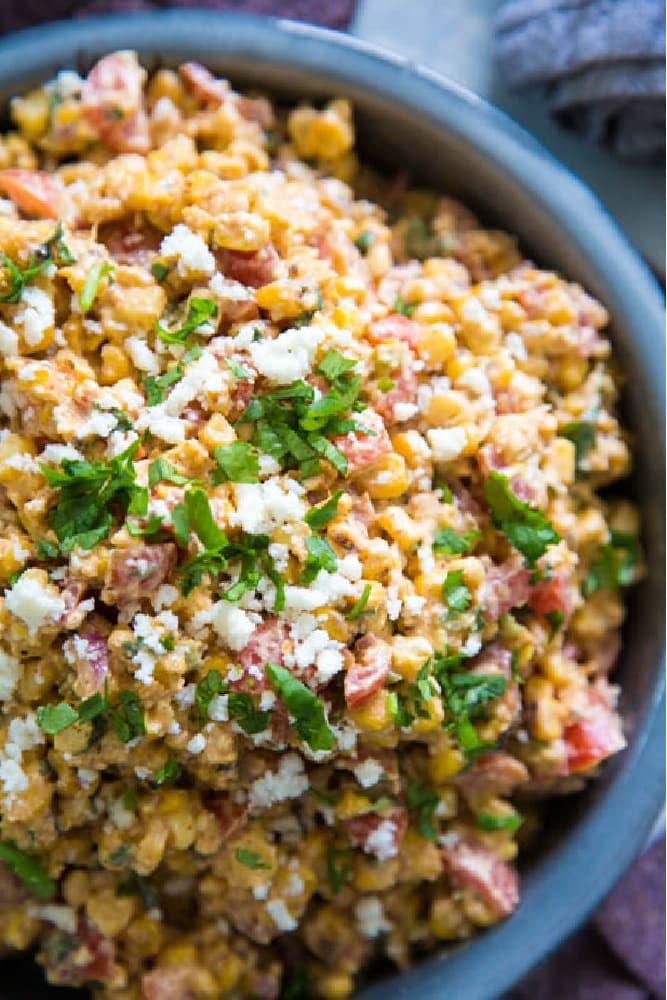 close-up photo of corn salad garnished with cilantro