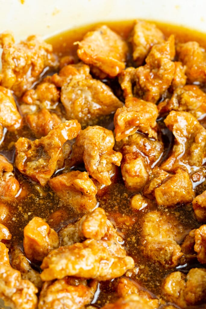 crispy chicken coated in honey garlic sauce.