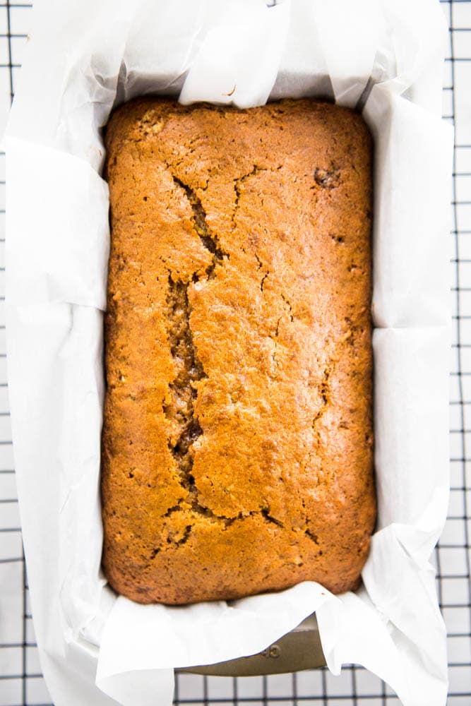 baked loaf of pumpkin zucchini bread in a pan.