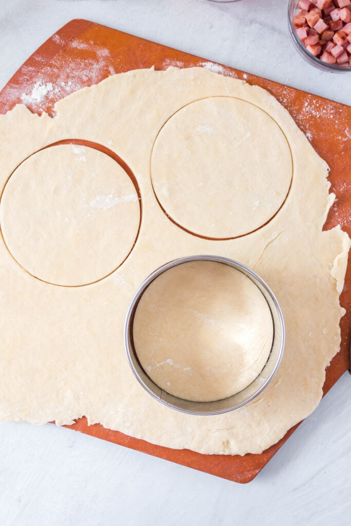 circles being cut out of the rolled out dough.