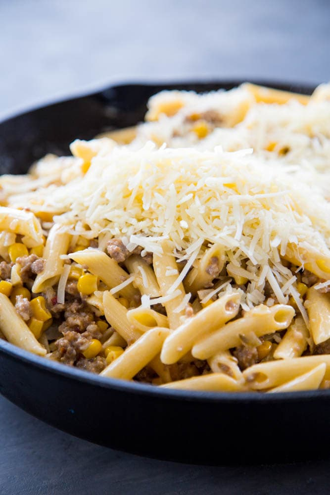 pasta, corn and sausage topped with cottage cheese