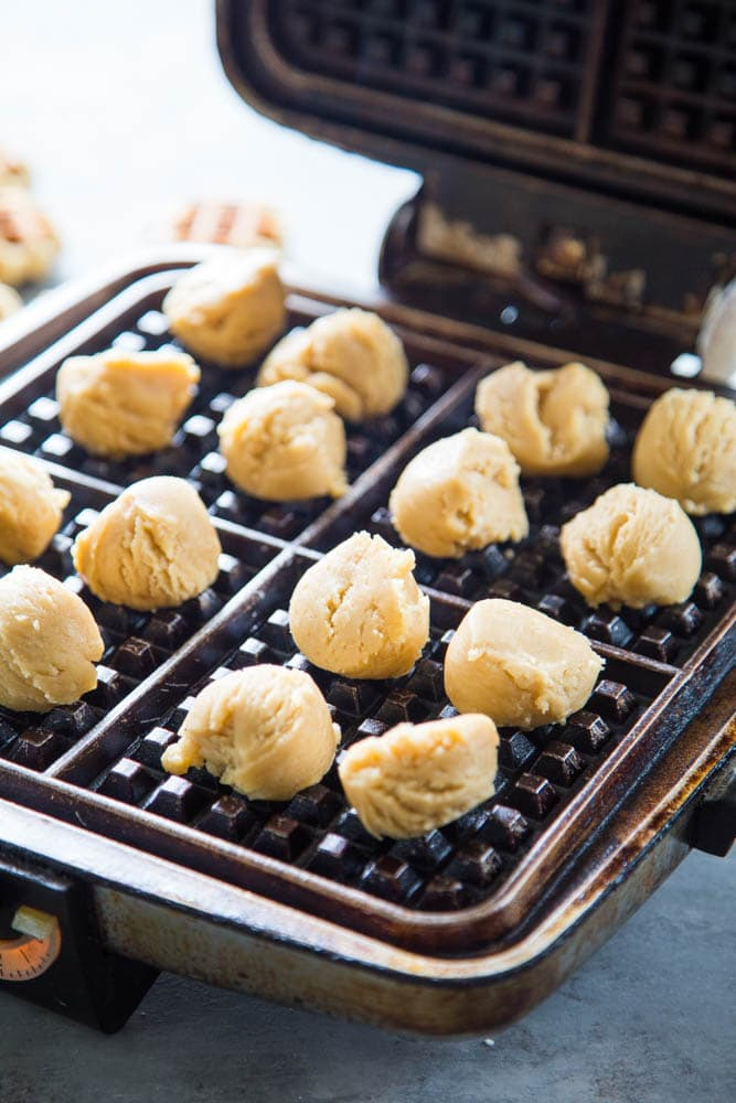 the dough balls placed on the waffle iron