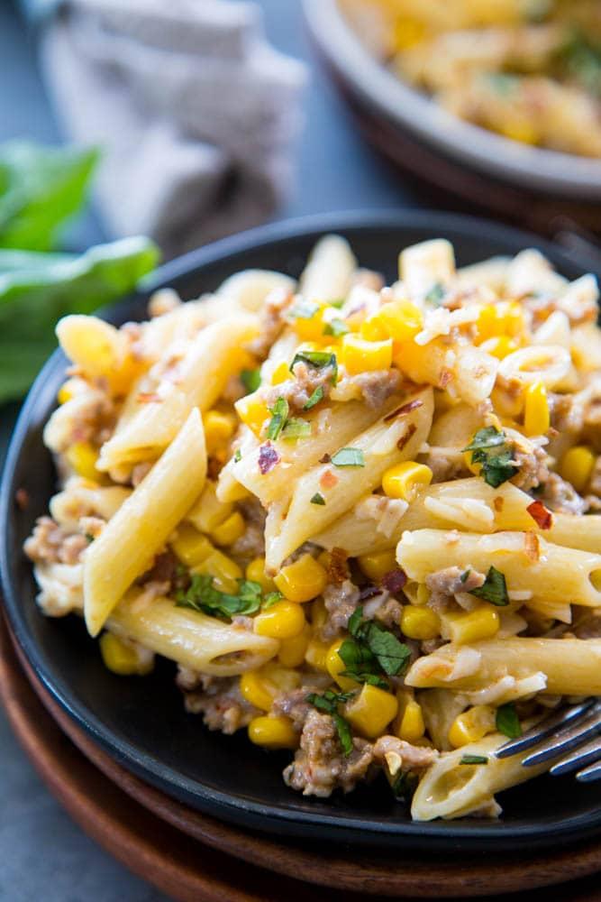 creamy sausage pasta on a plate