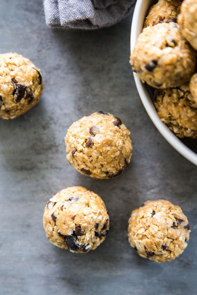 peanut butter protein balls next to a bowl.