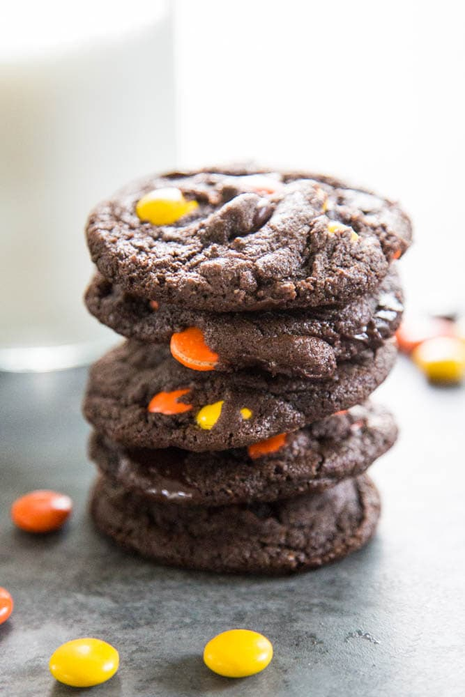a stack of chocolate reese's cookies.