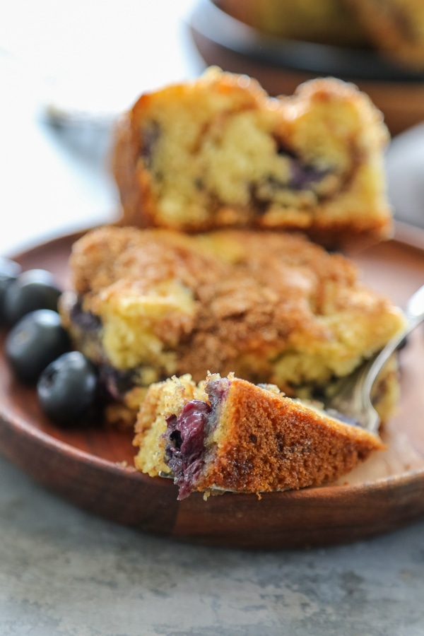 a piece of blueberry coffee cake on a fork.