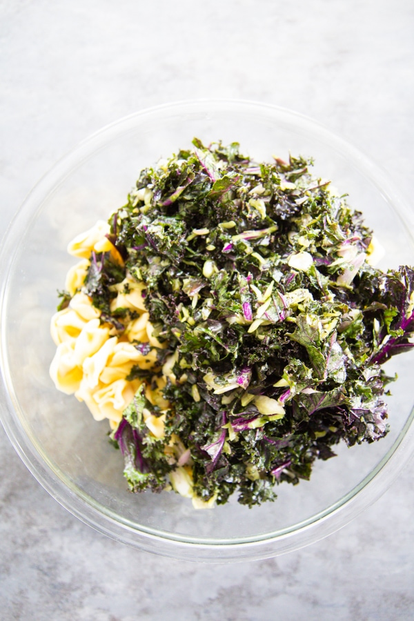 the kale and pasta in a bowl.