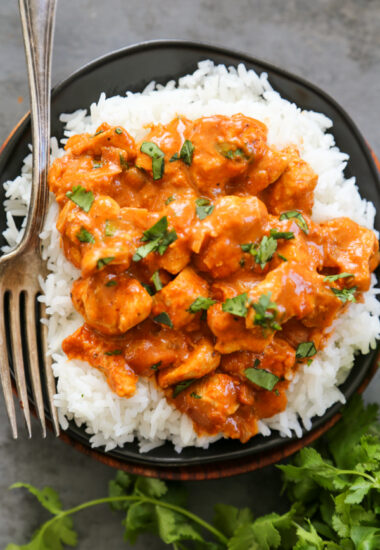 overhead photo of butter chicken with rice.
