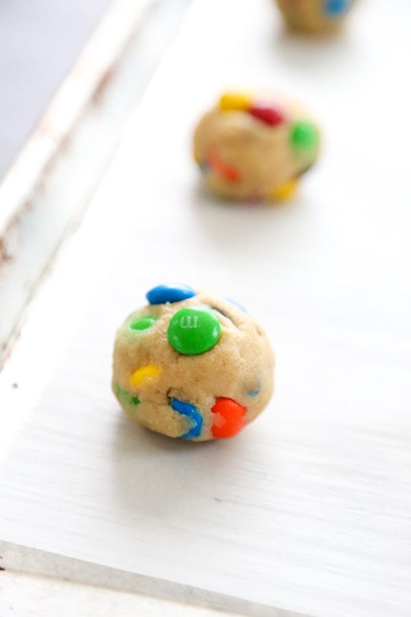cookie dough ball on the baking sheet.