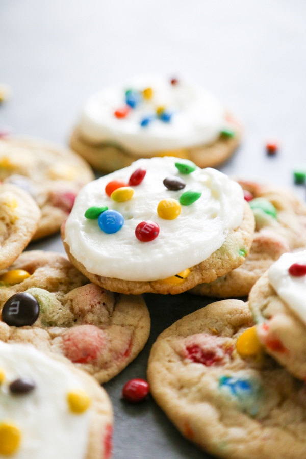 a frosted cookie on top of unfrosted ones.