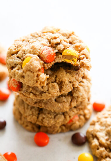 a stack of cookies with a bite taken out of the top one.