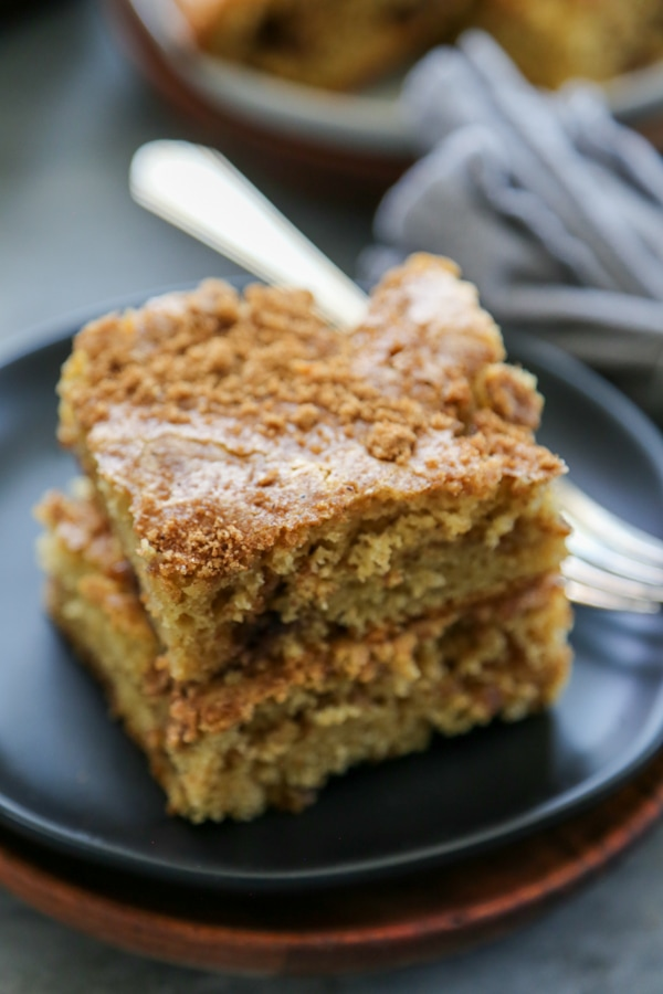close-up shot of two slices of pumpkin spice cake on a plate.