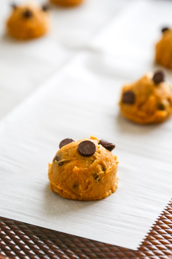 the cookie dough balls on the cookie sheet.