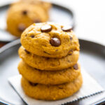 a stack of pumpkin chocolate chip cookies.