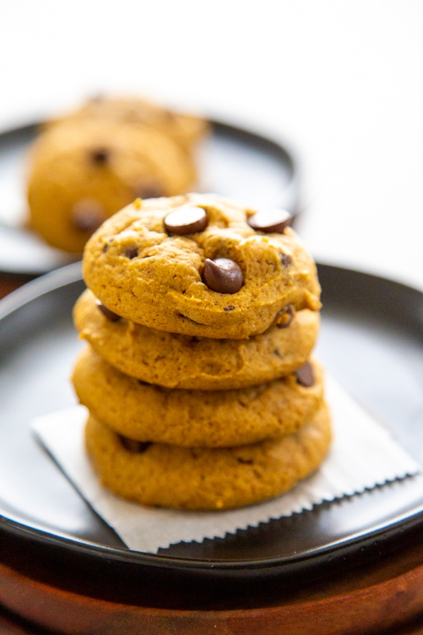 a stack of four pumpkin chocolate chip cookies.