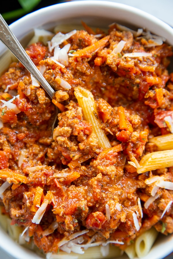 close-up shot of a bowl of pasta with a fork.