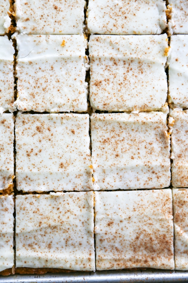 overhead photo of frosted and sliced pumpkin bars.