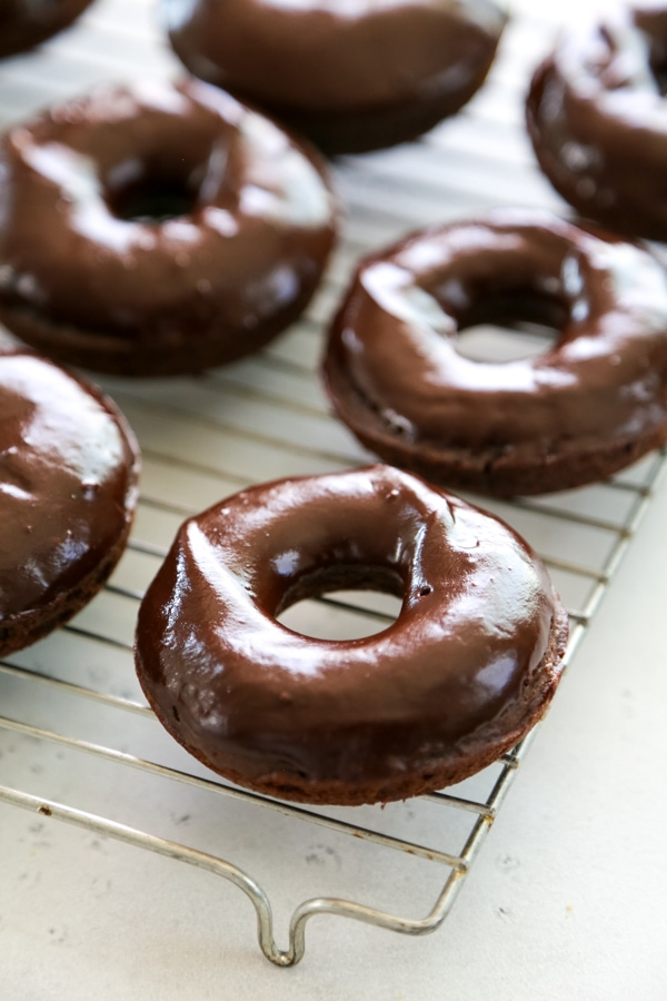 glazed donuts on a baking rack.
